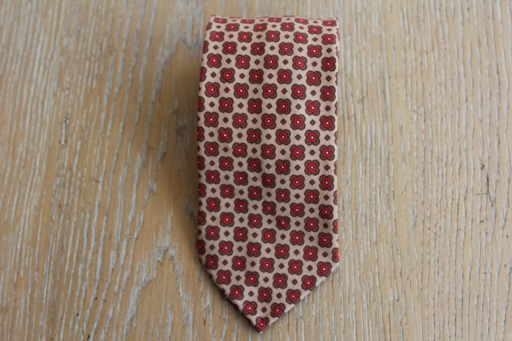 Cravatta fiori con sfondo marrone in lana
